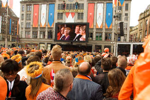Crowd follows Abdication ceremony on large screens