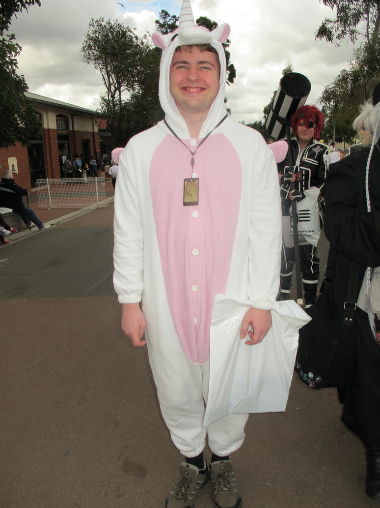 Grown Man In A Unicorn Onesie By Chickaablet