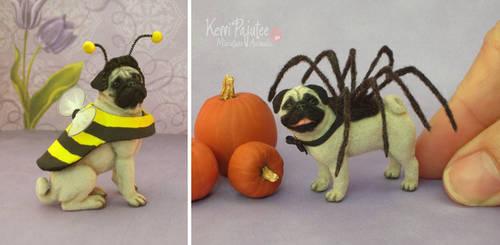 Miniature Pug sculptures in costume...