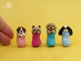 Miniature wrapped puppy sculptures by Pajutee