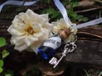 Alice in Wonderland necklace by Hiddendemon-666