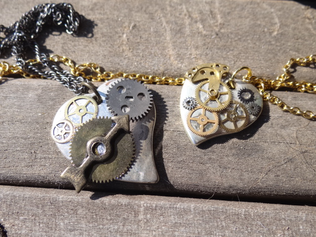 Steampunk heart necklaces by Hiddendemon-666