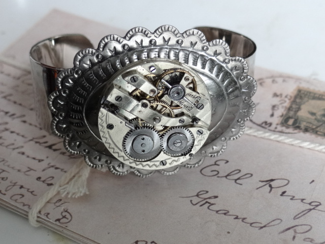Steampunk watch bracelet by Hiddendemon-666