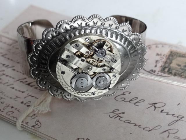 Steampunk watch bracelet by Hiddendemon-666
