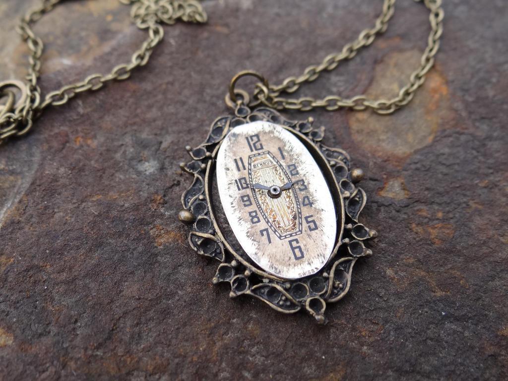 Steampunk watch face necklace by Hiddendemon-666