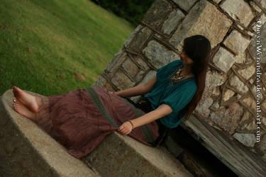 Sitting gypsy girl fixing skirt by QueenWerandra