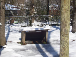 snow covered dog house 3