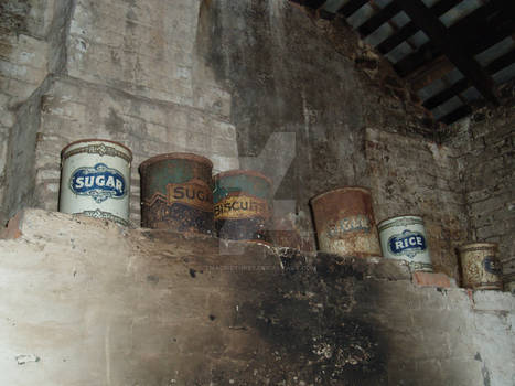 Old Tins Above Rundown Old Fireplace
