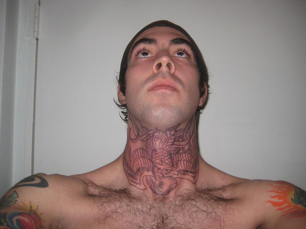 Phoenix Throat Tattoo