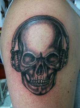 Skull with headphones tattoo