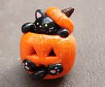 Black Cat in  a Pumpking Halloween Sculpture