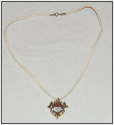 Lion Crest Necklace by ginsengi