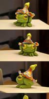 Frog in a hat flower sculpture
