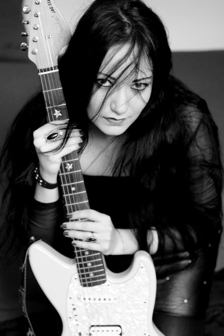 Shooting rock girl by Eve-VelvetRose