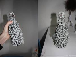 Bottle of bones by GingeriNosoulius