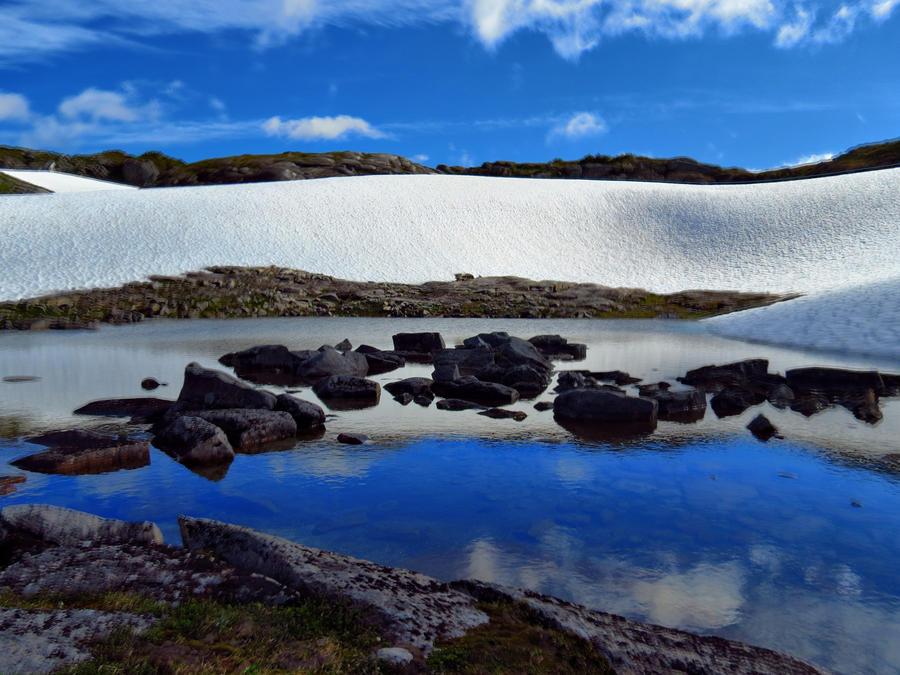 snow melt pond by Glacierman54