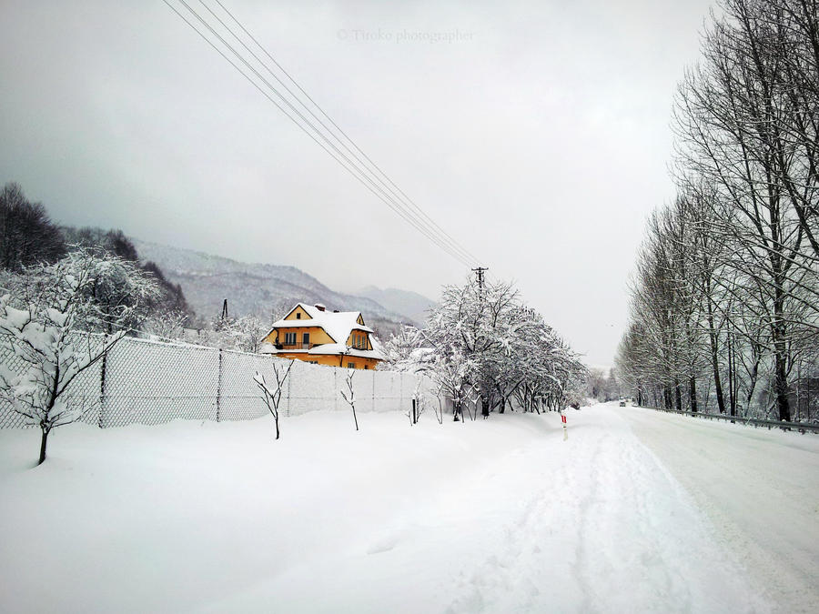 yellow house in the snow by Tiroko