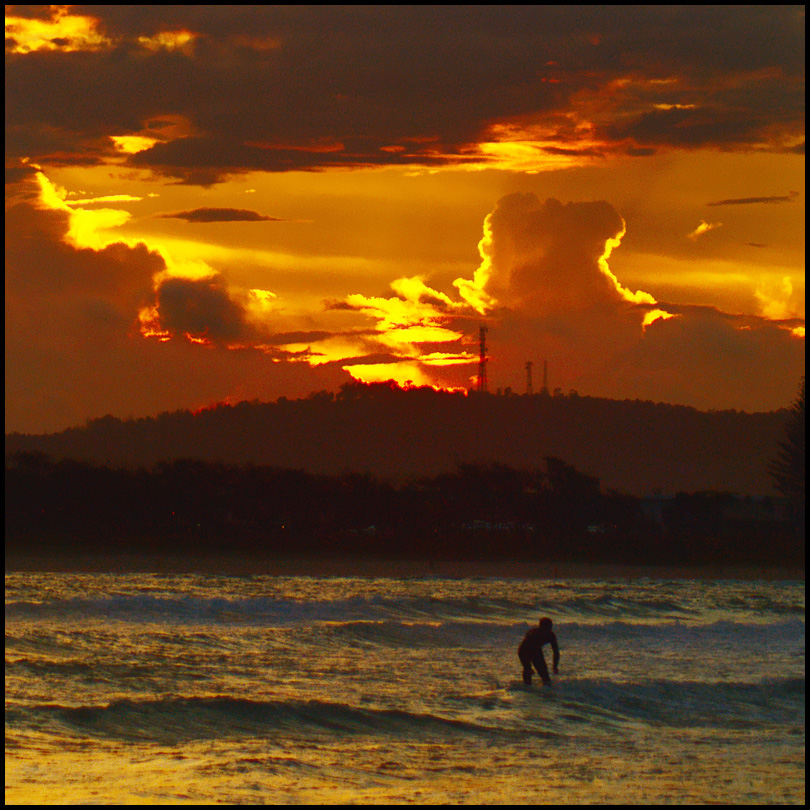 Surfer and sunset clouds by wildplaces