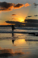 Surfing in sunset light 3 by wildplaces