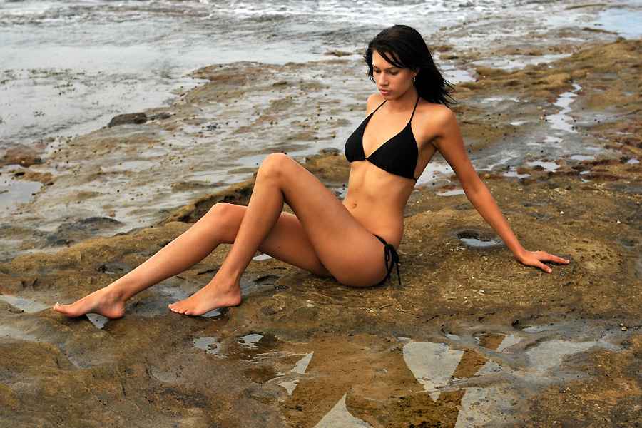 Teigan - black bikini on rock 1 by wildplaces