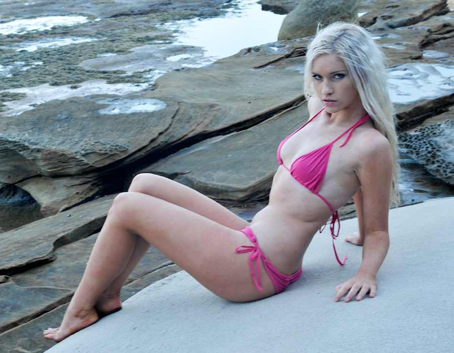 Kahli - pink bikini on rock by wildplaces