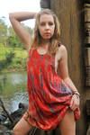 Riley Jade - orange dress pose 1