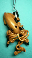 Golden Squid on Black Coral