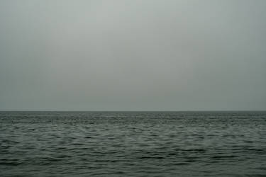 Overcast Sky and Calming Waters