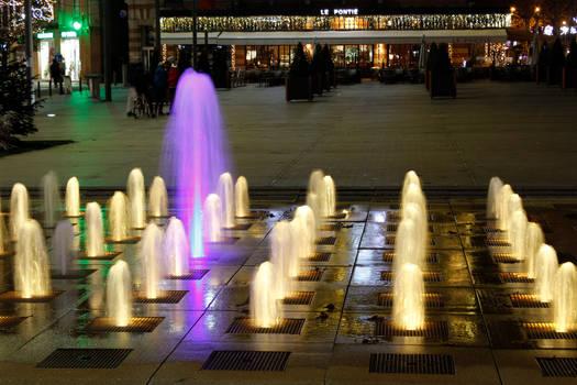 Illuminated fountain at night in Albi