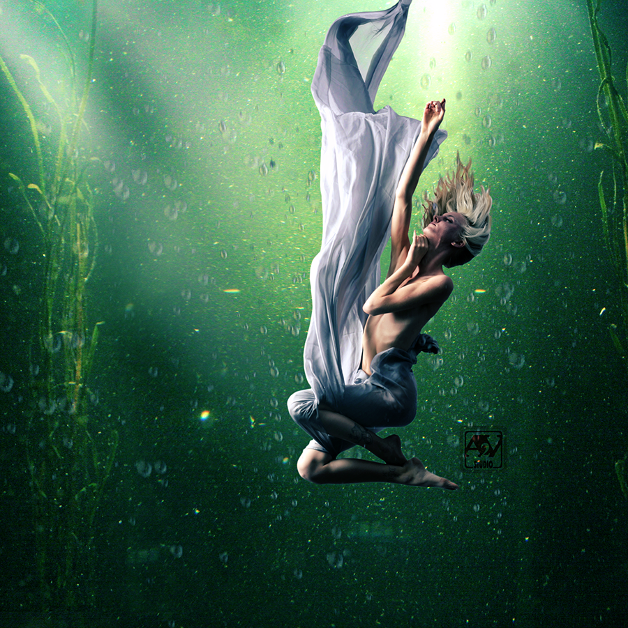 Person Falling Underwater Slow fall underwater by