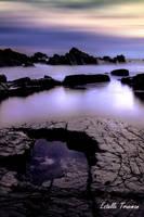 Half moon in the rocks at Hartland Quay by needcaffine