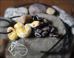 Albino and Royal Ball Python Pendants by NadilynBeato