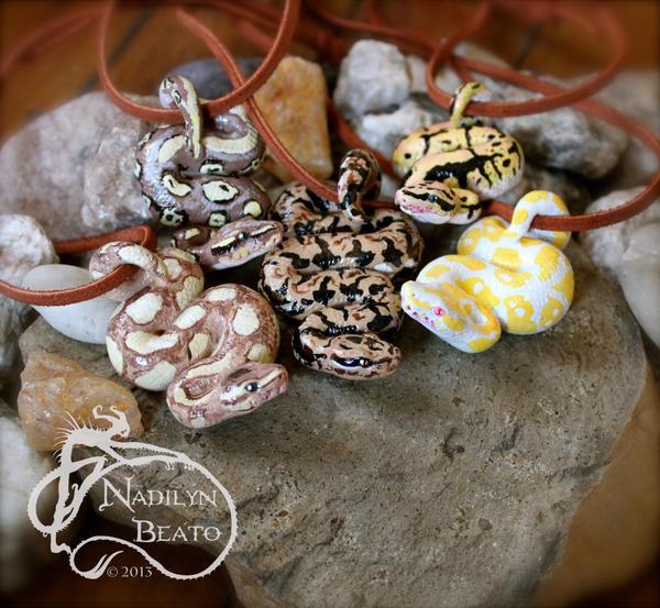 Ball Pythons and Dumerils Boa pendants by NadilynBeato