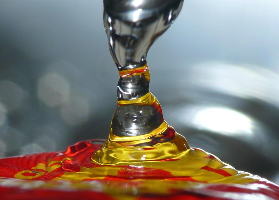 Water Flow onto Bottle Cap by BrandonCWatson