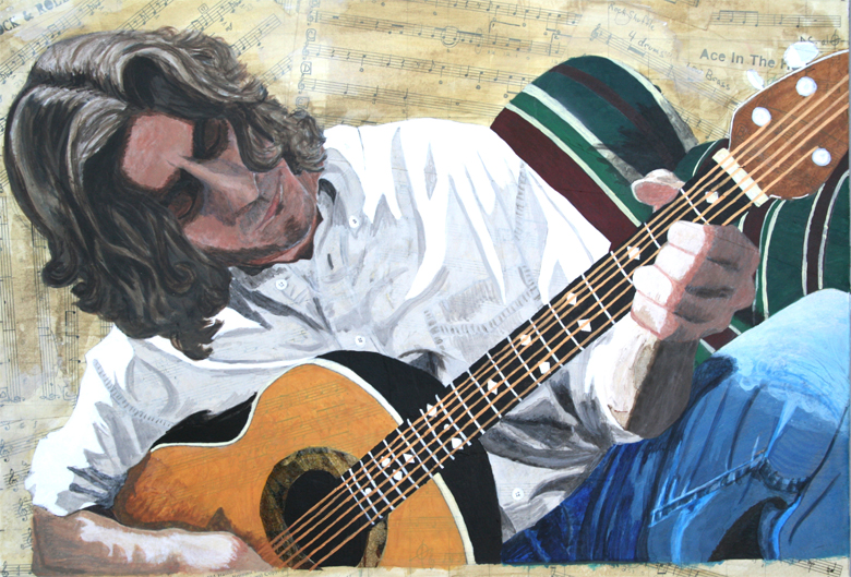 A guitarist tunes up