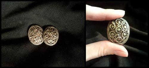 Tiny brooches