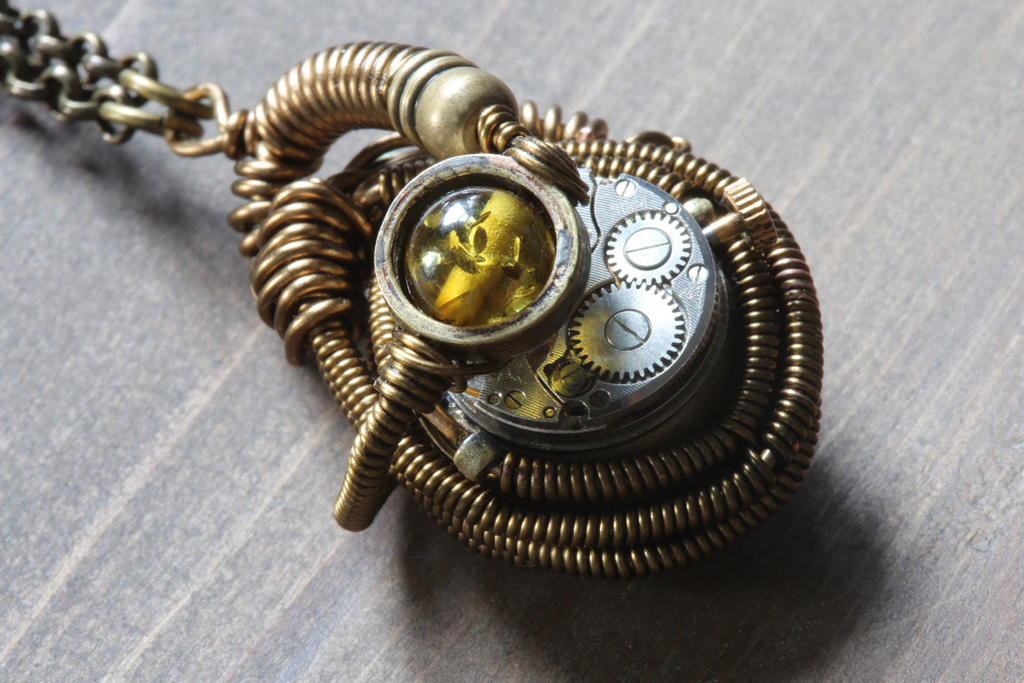 A new Steampunk pendant i made with green amber. by CatherinetteRings