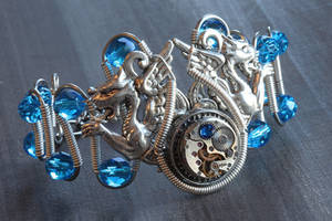 Steampunk Silver bracelet - dragons and blue beads by CatherinetteRings