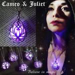 Magical purple glowing pendant