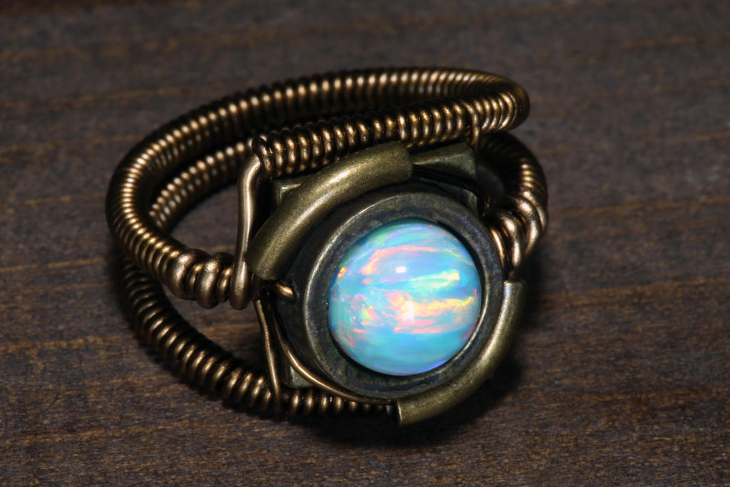 fire_and_ice_opal_steampunk_ring_by_catherinetterings-dbkdqh2.jpg