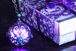 Magical glowing locket with opal