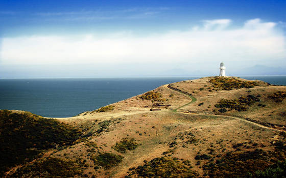 Lighthouse on Rugged Hills