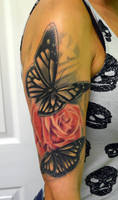 butterfly rose tattoo i did a while back by Rudeboytattoo