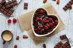 Cocoa pasta with raspberries and white choco sauce