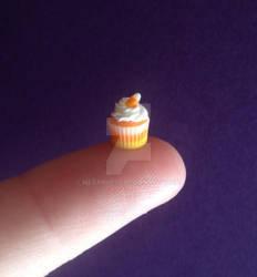 Miniature candy corn cupcake.