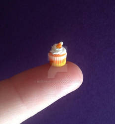 Miniature candy corn cupcake.