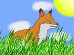 Fox laying in grass