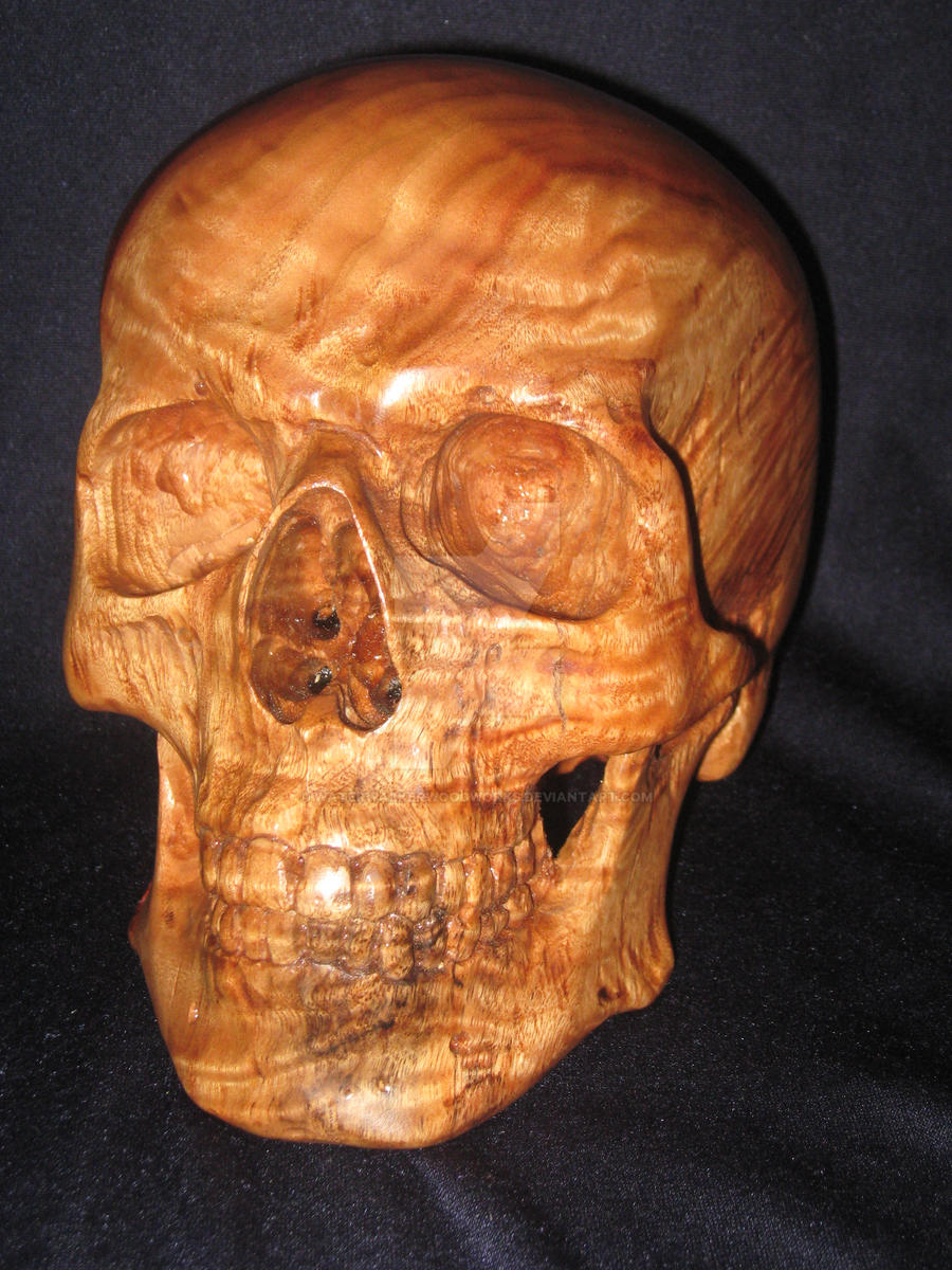 Carved wood skull in camphor by waterwalkerwoodworks on