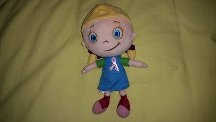 Annie plush with pink ribbon