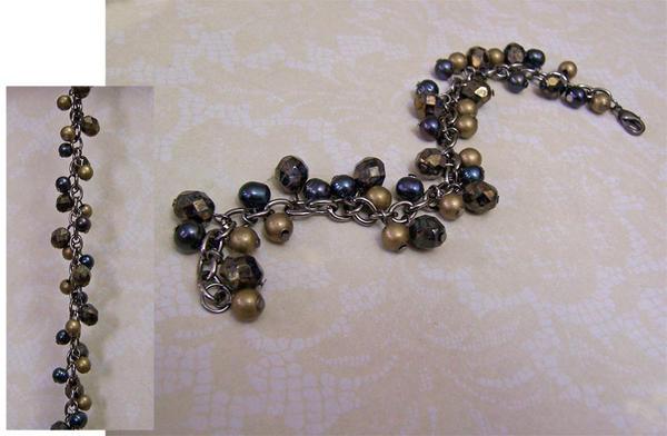 Dark gunmetal spiral bracelet by asukouenn